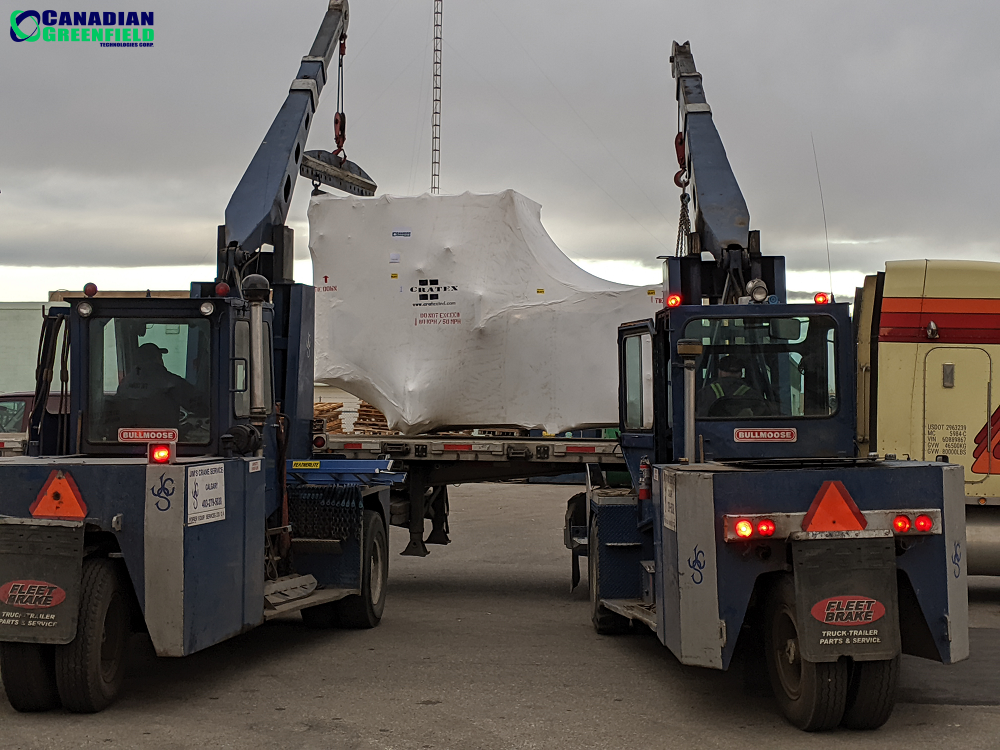 Package 1 of 17 of a HempTrain™ Advanced Processing Plant being loaded for shipment.